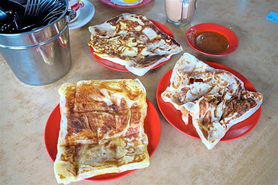 Chinese man loves roti canai so much he opens a shop to sell it