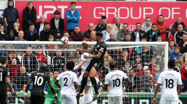 Jamaal Lascelles stars at both ends as Newcastle beat Swansea