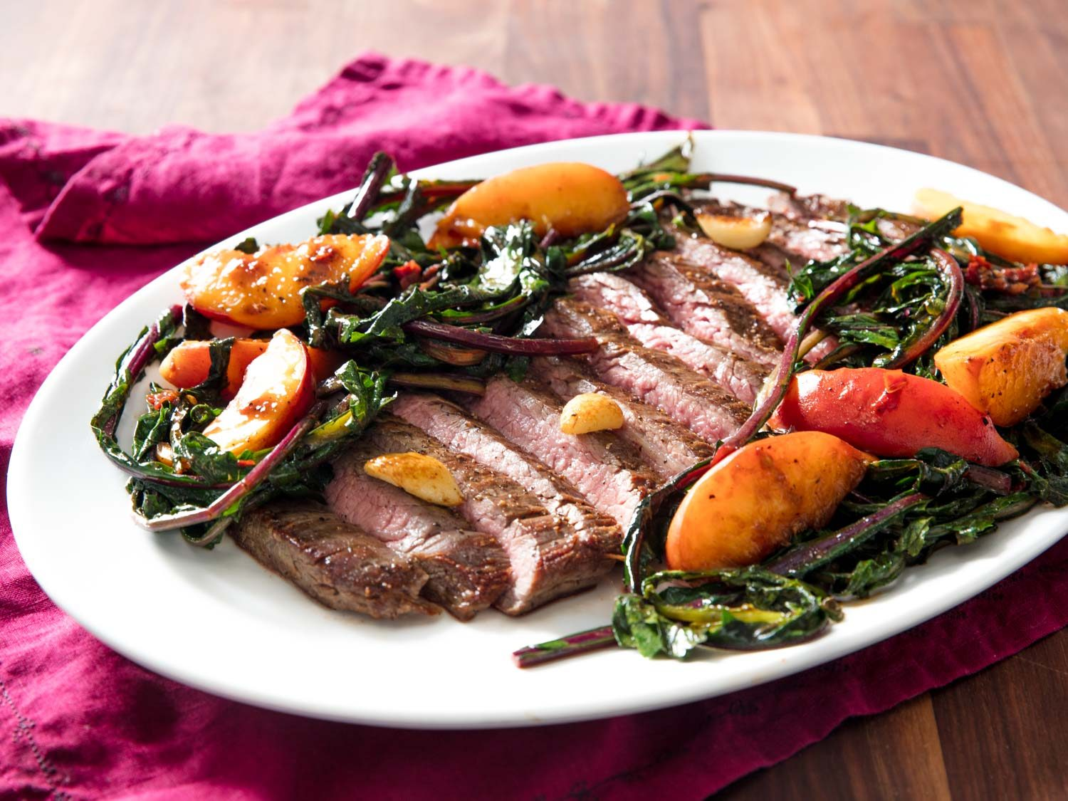 Pan-Seared Flank Steak With Peaches and Dandelion Greens